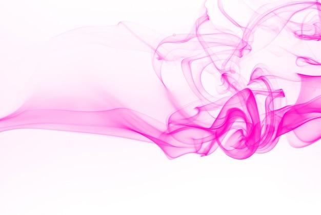 Beautiful pink smoke abstract on white background Premium Photo
