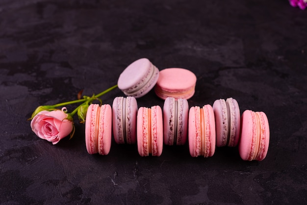 Beautiful pink tasty macaroons on a concrete background Premium Photo