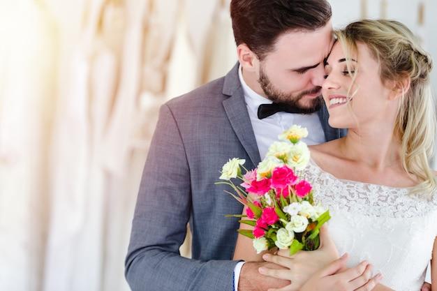 Beautiful portrait model wedding couple in studio shop Premium Photo