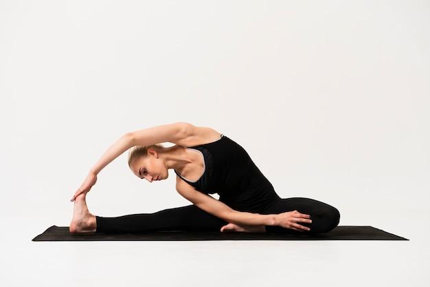 Beautiful pose at yoga class indoor Free Photo