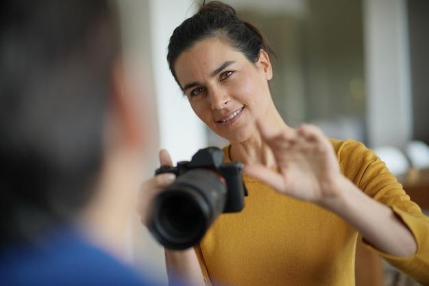 Beautiful professional photographer taking photos of a model Premium Photo