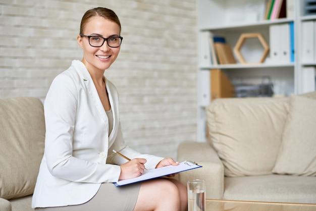 Beautiful psychiatrist posing in office Premium Photo