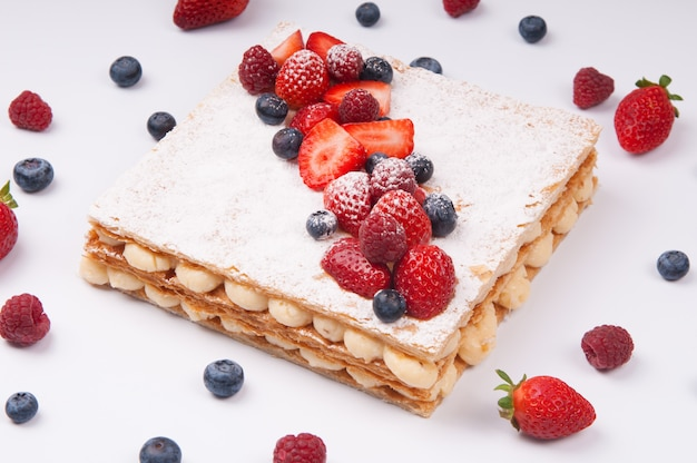 Beautiful puff pastry cake decorated with berries Free Photo