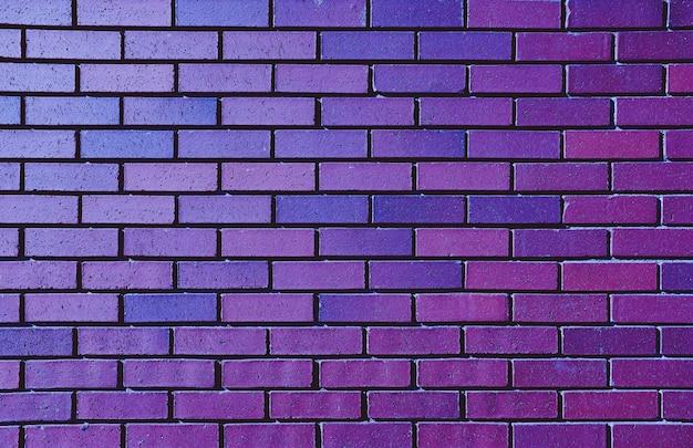 背景の美しい紫レンガの壁 無料写真