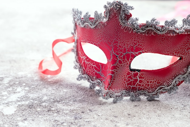 Beautiful red carnival mask for carnival holiday background concept on stone Premium Photo