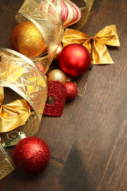 Beautiful red and gold christmas decoration on wood Premium Photo