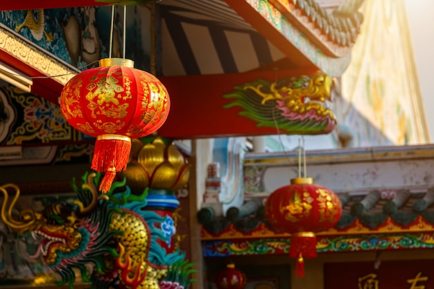 Beautiful red lantern decoration for chinese new year festival at chinese shrine ancient chinese art, the chinese alphabet blessings written on it,is a public place thailand Premium Photo