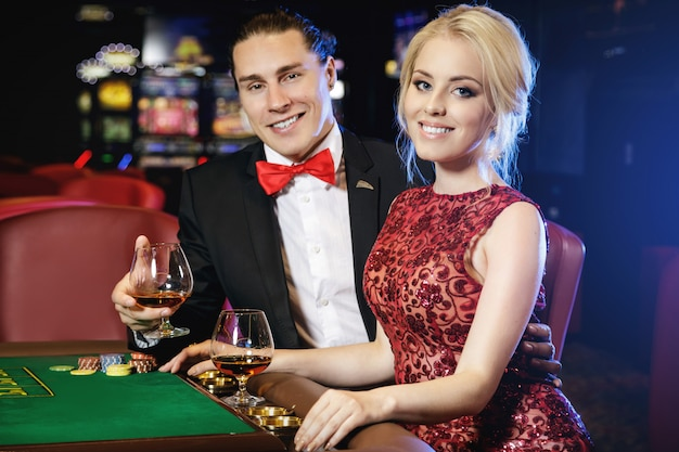 Premium Photo | Beautiful and rich couple playing roulette in the casino
