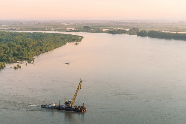 Beautiful river landscape with green shores and ship with copy space. Premium Photo