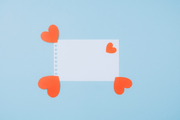 Beautiful romantic background with white text box and hearts. Premium Photo
