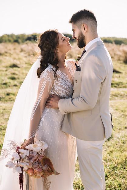 Beautiful Romantic Wedding Couple Of Newlyweds Hugging Premium Photo
