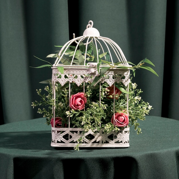 Beautiful roses in white cage Free Photo