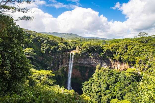 Beautiful scenery of chamarel waterfall in mauritius under a cloudy sky Free Photo