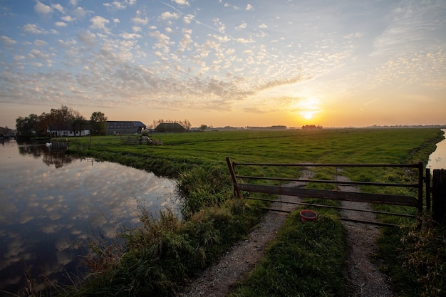 Beautiful scenery of a dutch polder landscape during sunset Free Photo