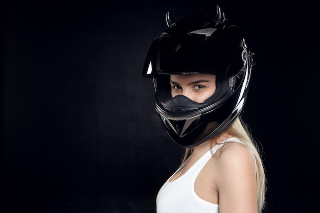 Beautiful self determined young european woman motorcyclist wearing white tank top Free Photo