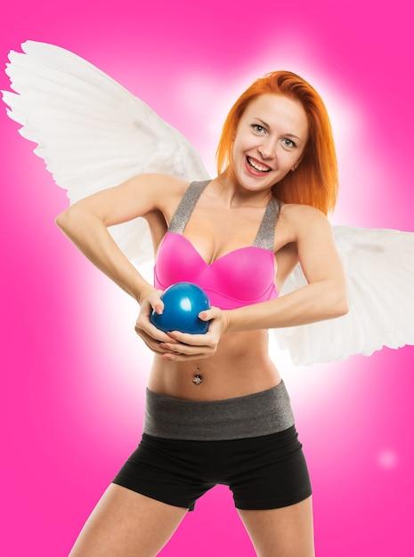 Beautiful sensual angel doing fitness Free Photo