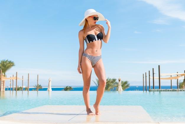 Beautiful sexy woman near pool Free Photo