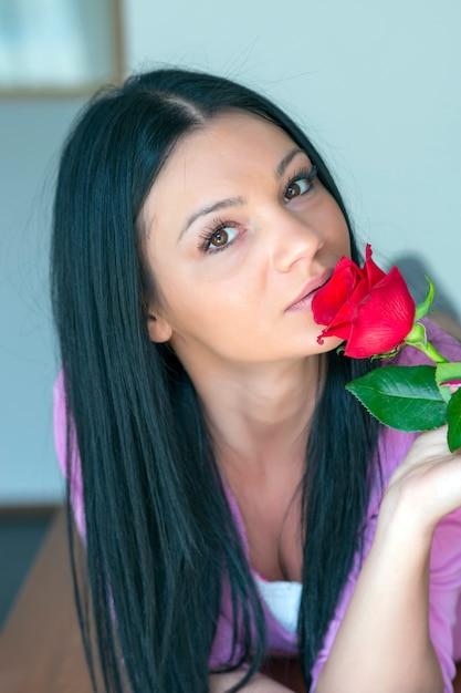 Beautiful sexy young woman holding single rose Premium Photo