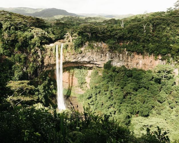 Beautiful shot of a chamarel waterfall in the jungle of mauritius island Free Photo