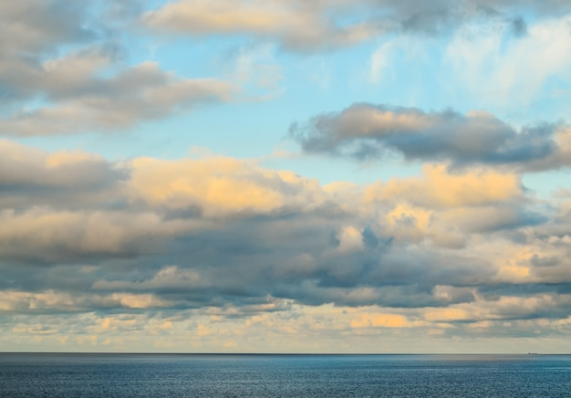 Beautiful shot a cloudy sky in the ocean Free Photo
