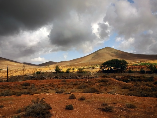 Beautiful shot of drylands of corralejo natural park in spain during stormy weather Free Photo