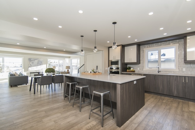 Beautiful shot of a modern house kitchen and dining room Free Photo