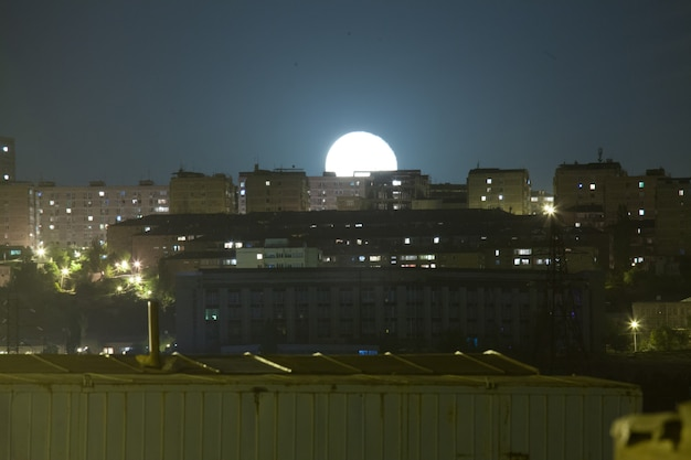 Beautiful shot of the moon over the beautiful city of yerevan during nighttime Free Photo