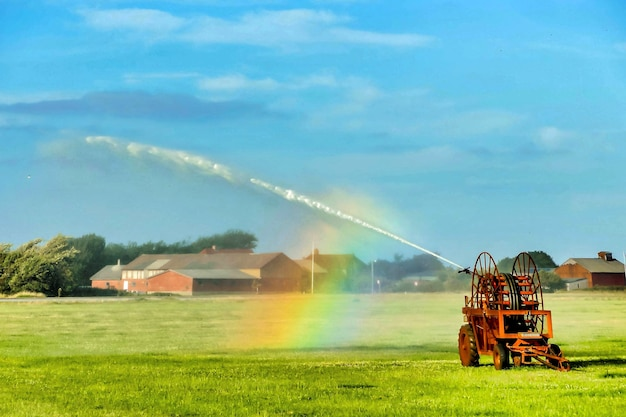 Beautiful shot of a rainbow forming from a water sprinklers Free Photo