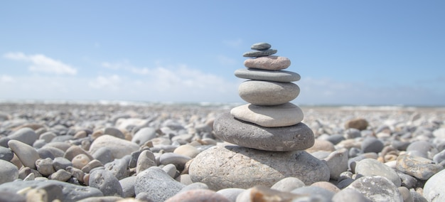 Beautiful shot of a stack of rocks on the beach Free Photo