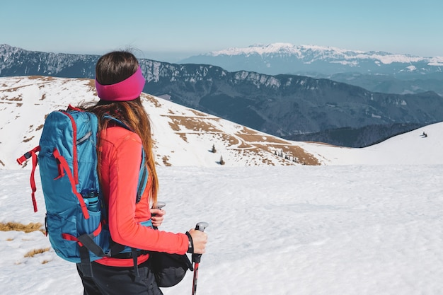 Beautiful shot of a woman looking at the carpathian mountains in romania Free Photo