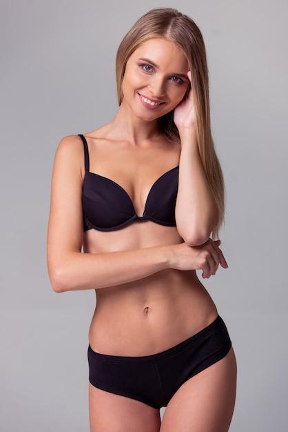 Beautiful slim girl in black lingerie is posing. Premium Photo