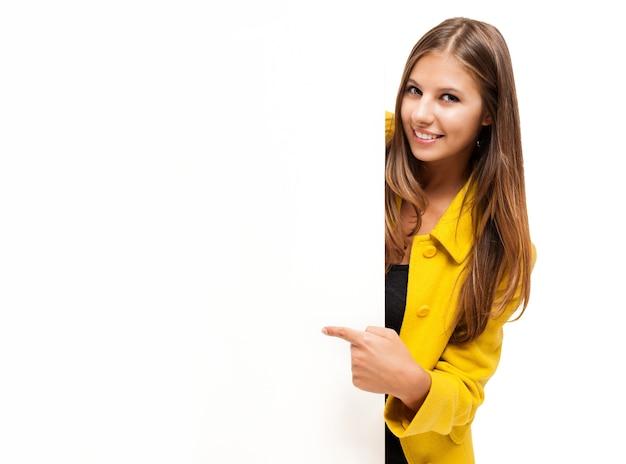 Beautiful smiling woman showing a blank board Premium Photo