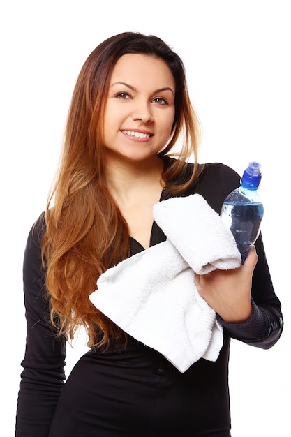Beautiful smiling woman with bottle of water Free Photo