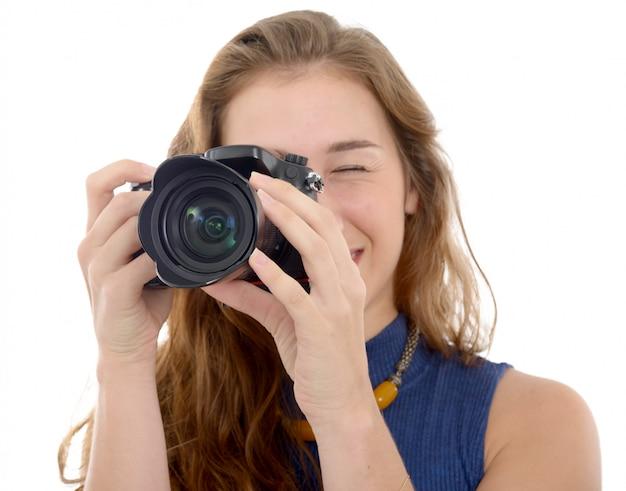 Beautiful smiling woman with digital camera, on white Premium Photo