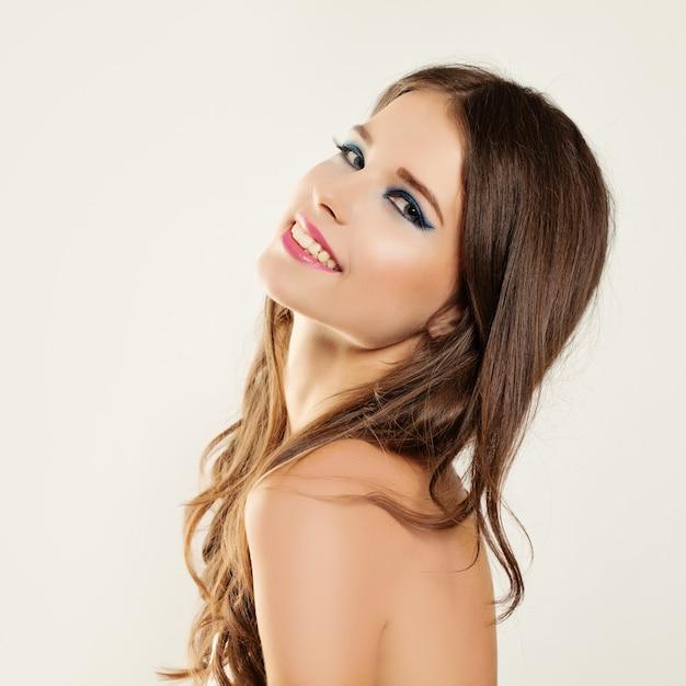 Beautiful smiling woman with elegant makeup Premium Photo