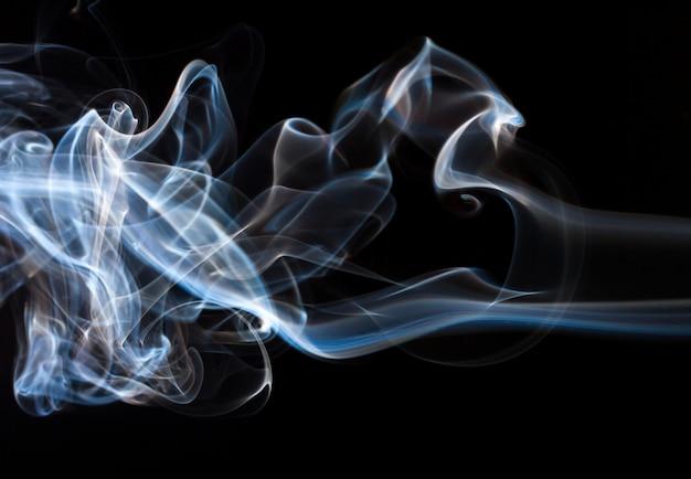 Beautiful smoke abstract on black background, fire design Premium Photo