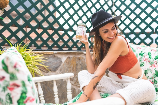 Beautiful spanish woman relaxing in a terrace at home. Premium Photo