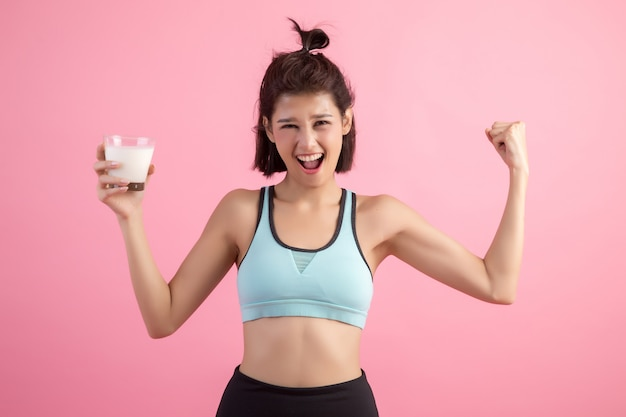Beautiful sport woman drinking milk Free Photo