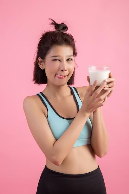 Beautiful sport woman drinking milk Free Photo