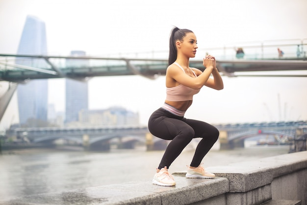Beautiful sportive girl training in the street Premium Photo