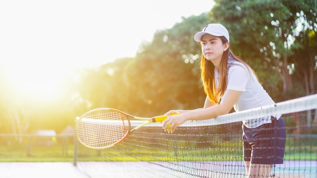 3a89f922c Beautiful sports women relaxing happy with with racket at the tennis Premium  Photo
