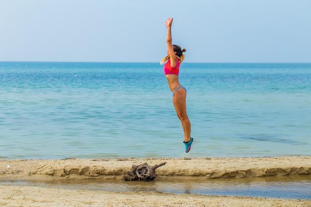 Beautiful sporty girl on the beach sports Free Photo