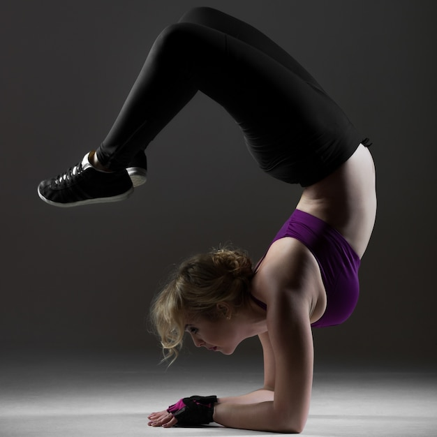 Beautiful sporty girl doing backbend on forearms Free Photo
