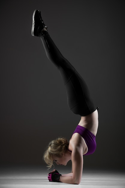 Beautiful sporty girl doing handstand Free Photo