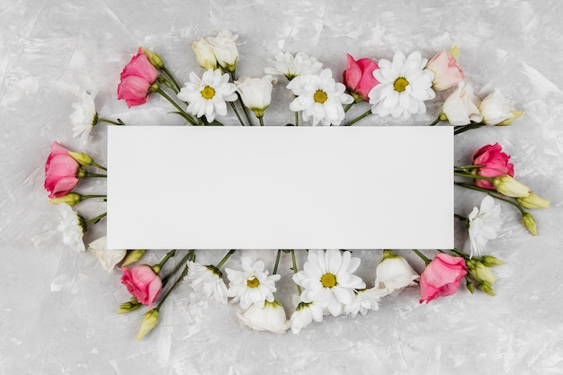 Beautiful spring flowers composition with empty frame Free Photo