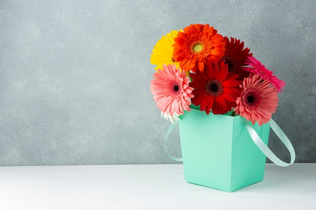 Beautiful spring gerbera flowers in a bucket Premium Photo