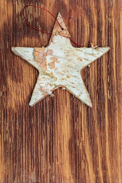 Beautiful star of birch bark. ready for christmas greeting. Premium Photo