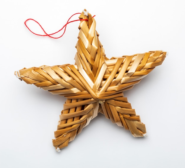 Beautiful star made from vegetable fibers isolated Premium Photo