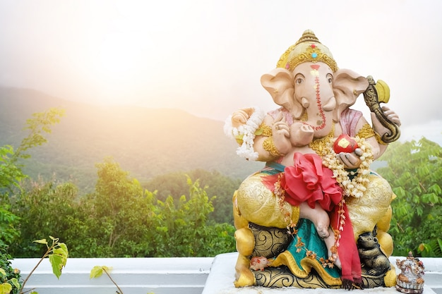 A beautiful statue of ganesh on the background landscape Premium Photo