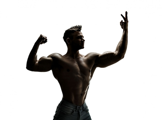 The beautiful and strong young guy, silhouette Premium Photo